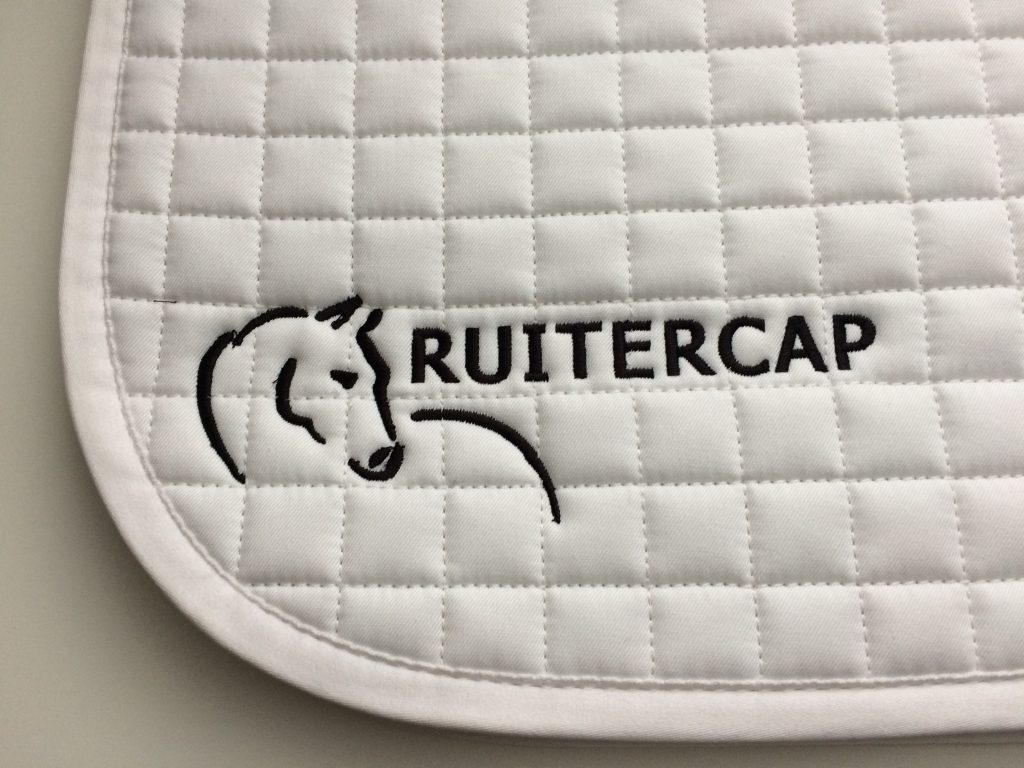 Equestrian sports, saddle pad with company logo, Ruitercap, by ZijHaven3, borduurstudio Lemmer