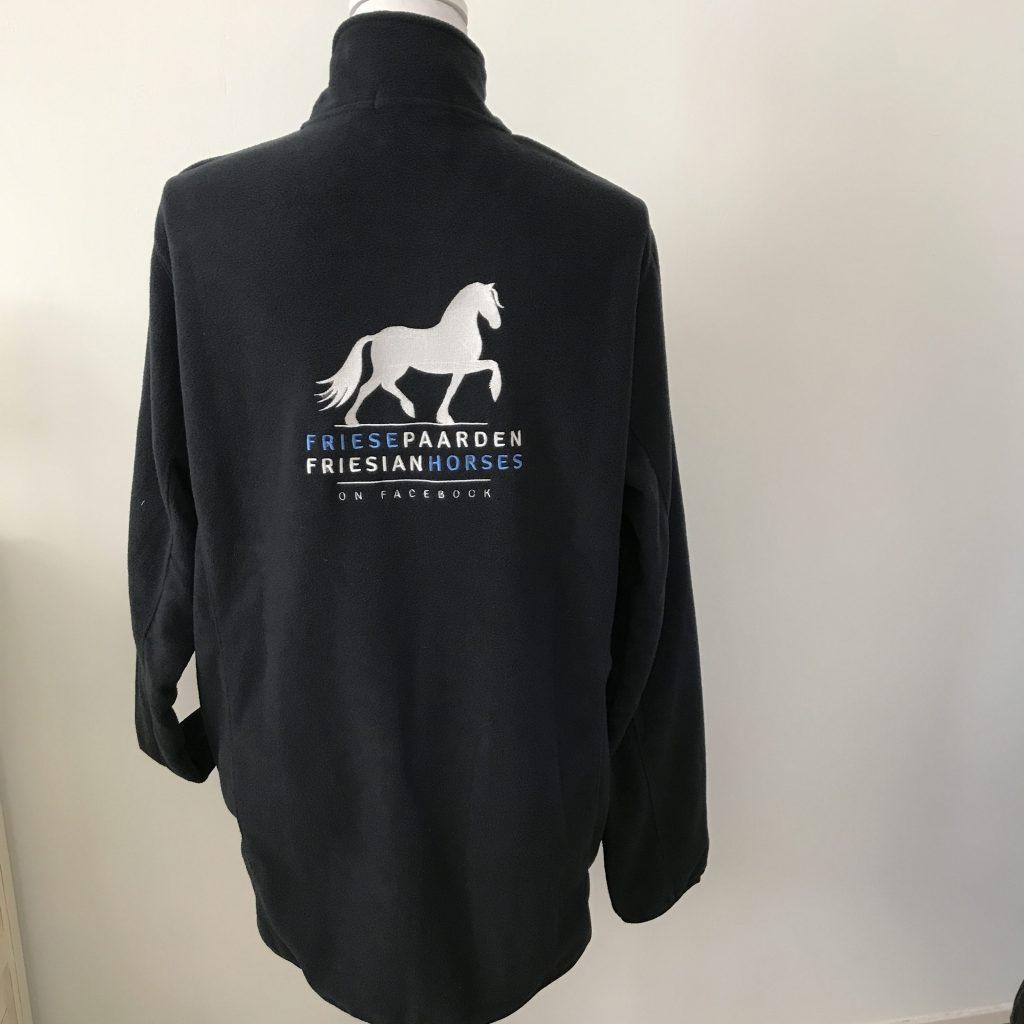 Equestrian sport, example of quilted unisex fleece vest, dark navy, with logo Friese Paarden / Friesian Horses, by ZijHaven3,borduurstudio Lemmer