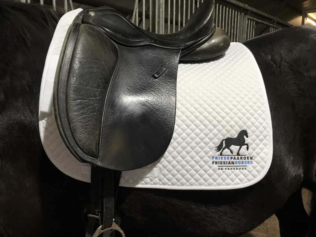 Saddle pad with logo of Fries Paarden / Friesian Horses, by ZijHaven3, borduurstudio Lemmer
