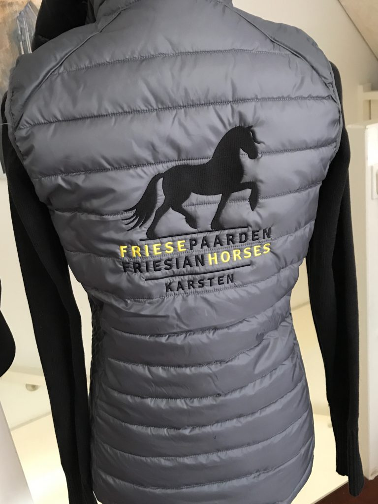 Bodywarmer ladies, grey, with logo Friese Paarden / Friesian Horses by ZijHaven3, borduurstudio Lemmer