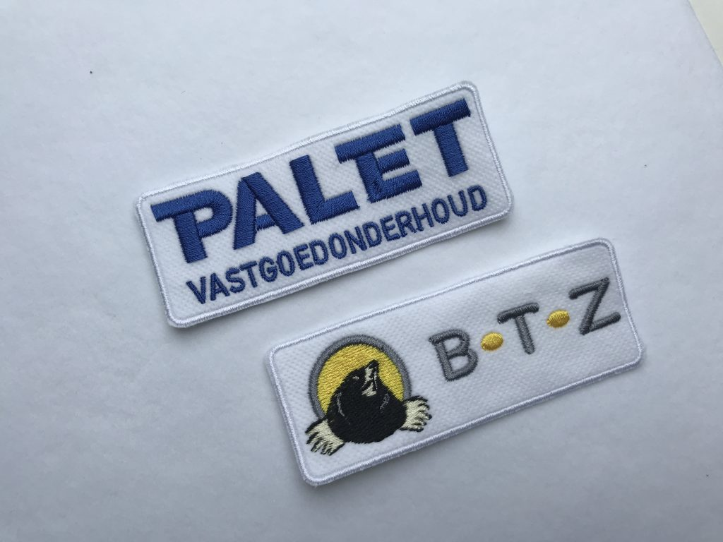 Company gear, pads with company logo, by ZijHaven3, borduurstudio Lemmer