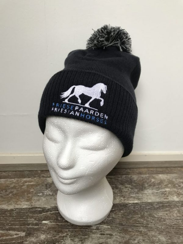 Knitted hat with pompon, dark navy, with logo Friese Paarden / Friesian Horses, by ZijHaven3 borduurstudio Lemmer