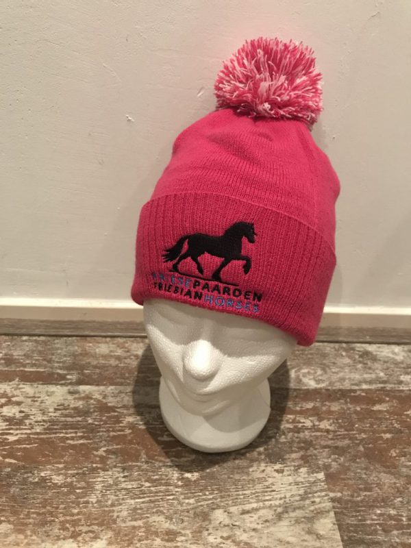Knitted hat with pompon, pink, with logo Friese Paarden / Friesian Horses, by ZijHaven3 borduurstudio Lemmer