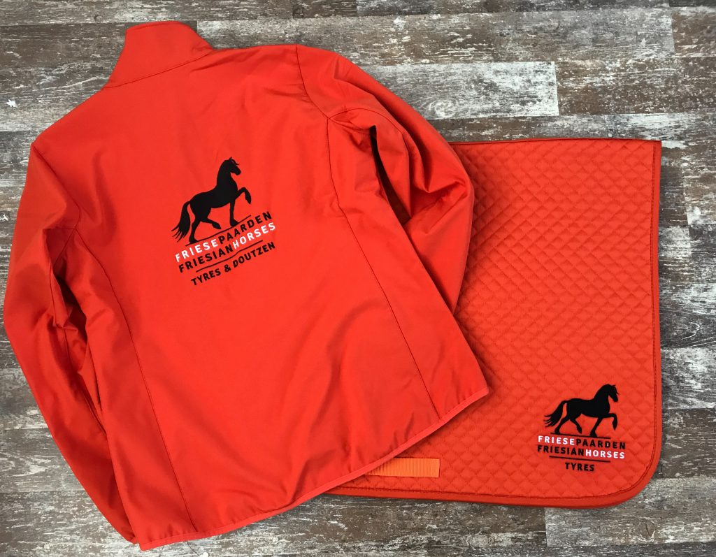 Equestrian sports, saddle pad and matching softshell jacket with logo Friese Paarden/Friesian Horses, by ZijHaven3, borduurstudio Lemmer