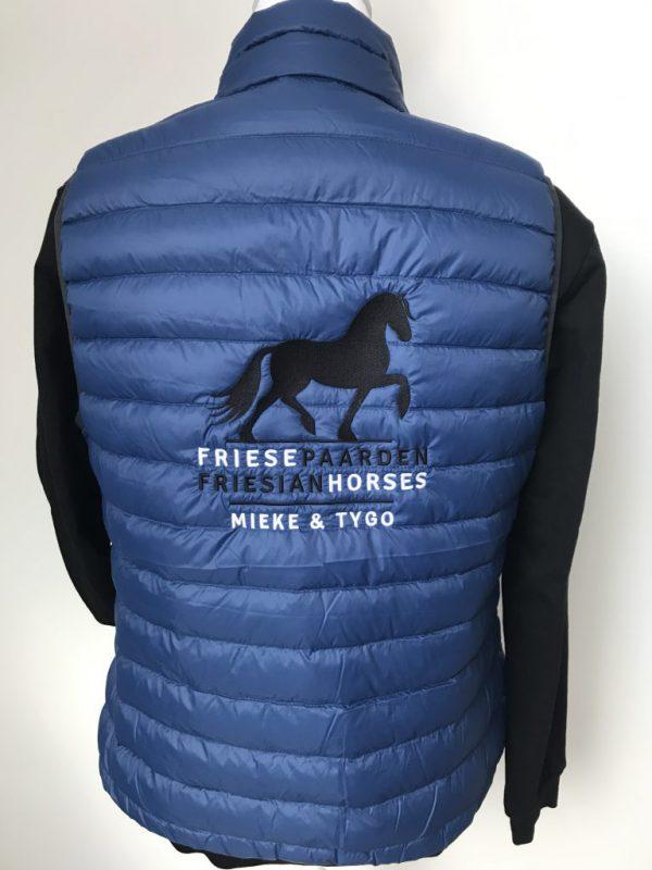 Ladies Down vest, indigo blue, with logo Friese Paarden/Friesian Horses, by ZijHaven3, borduurstudio Lemmer